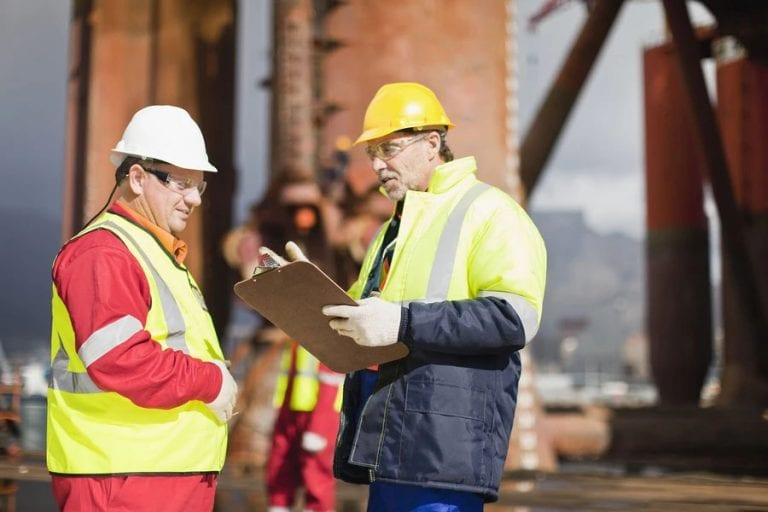 oil and gas consultant on-site safety meeting